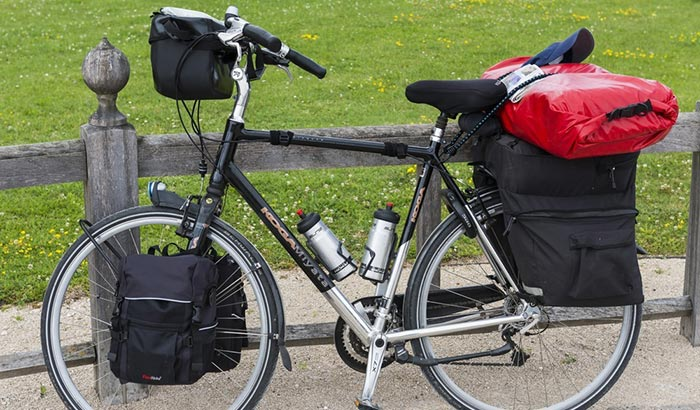 how to carry multiple bags of cans at once on a bike